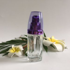 30ml Glass Bottle with Alumite Silver Lotion Pump pictures & photos