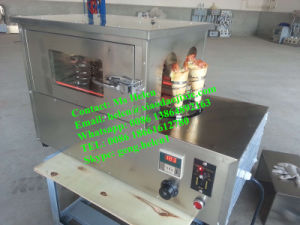 Pizza Cone Machine/Pizza Oven/Snack Machine pictures & photos