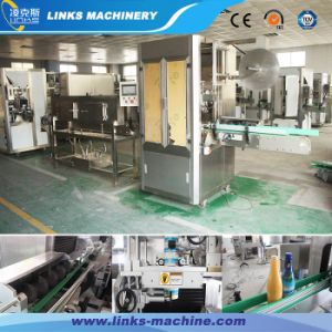 Fully Automatic PVC Label Shrinking Packing Machine pictures & photos