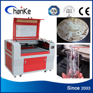 CO2 Laser Engrave and Cutting Machine for Cutting Farbic PVC pictures & photos