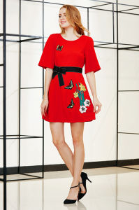 Latest Fashion Solid Skating Dress with Embroidery Patch and Bow Tie on Waist Band