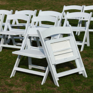 Resin Folding White Chairs At Outdoor Party