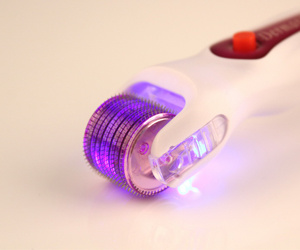DNS Se Replacebale Head LED Light Vibrator Dermaroller Skin Beauty Devices pictures & photos