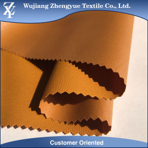 100% Polyester Dobby Waterproof Stretch Jacket Fabric with PU/TPU Lamination pictures & photos