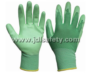 Nylon Knitted Working Gloves with Smooth Nitrile Coated (N1569C) pictures & photos