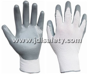 Nylon Knitted Work Glove with Sandy Nitrile Dipping (N1552) pictures & photos