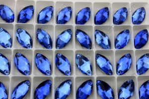9X18mm Capri Blue Dz-3066 Navette Stone Sew on Rhinestone with 2 Holes pictures & photos