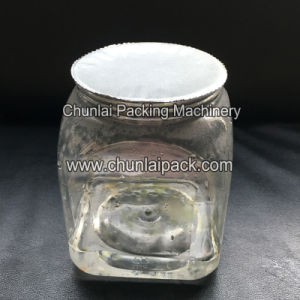 Big Plastic Jar Sealing Machine pictures & photos
