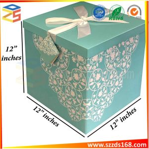 Gift Box With Decorative Ribbon Mounted On The Lid Tag And Tissue Paper