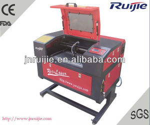 Table up and Down Automatic CO2 Laser Engraving and Cutting Machine pictures & photos