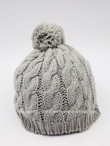 100% Acrylic Cable Knitted Hat with Pompom pictures & photos