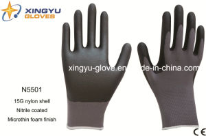 Nylon Shell Nitrile Coated Microthin Foam Safety Work Gloves (N5501) pictures & photos