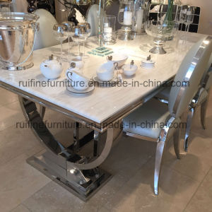 Modern Cream Marble Chrome Dining Table With U Shaped Legs And Snake Chair