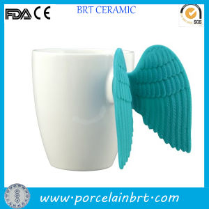 Creative Ceramic White Angle Wing Mug pictures & photos