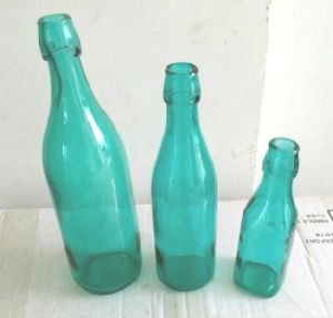 Empty Colored Wine Glass Bottle with Swing Top pictures & photos