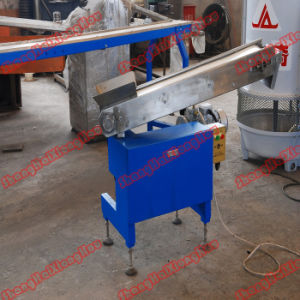 Swing Discharger for Candy Machine pictures & photos