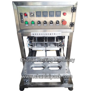 Semi-Automatic Moisture Absorber Box Sealing Machine pictures & photos