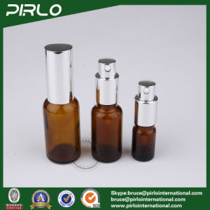 Luxury Amber Glass Bottles with Silver Pump and Cap pictures & photos