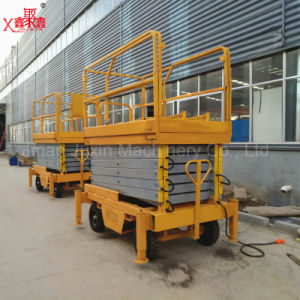 12 Meter Hydraulic Mobile Scissors Man Lift Window Cleaning Lift pictures & photos