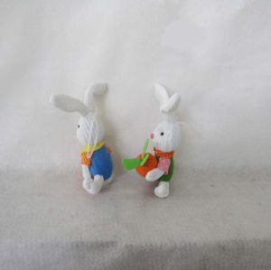 Easter Boy and Girl Bunny Playing with Carrots pictures & photos