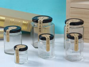 Hexagonal Glass Jar/ Glass Container/ Glass Bottle pictures & photos