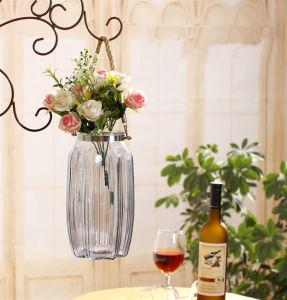 Подвешенные стекло вазы с помощью веревки