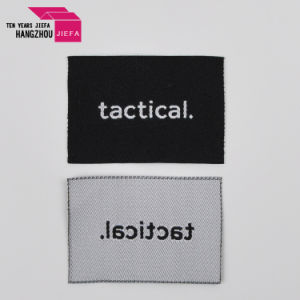 スーツのための工場価格のブランドのロゴの中央見開きページによって編まれるラベルかTシャツまたはジーンズ