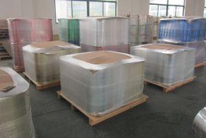De PVC y PET metalizado (Película de poliéster).
