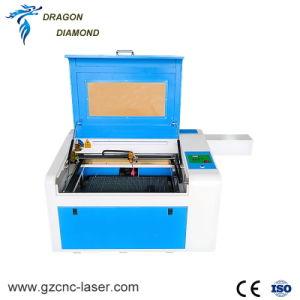 回転式装置が付いている非金属600*400mmの木製のアクリルファブリック小さいレーザーの打抜き機
