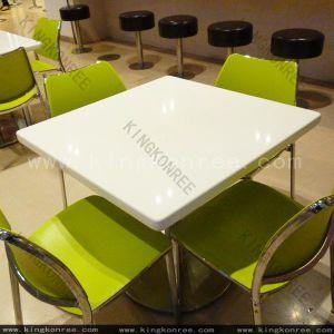 4 asientos superficie sólida sobre la mesa de comedor Top
