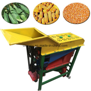 La semilla de maíz maíz eléctrico Busking bombardeo de la máquina de trilla.