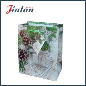 반짝임 크리스마스 쇼핑 선물 부대를 가진 주문품 광택지