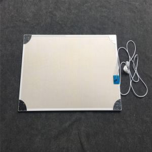 Установка на стену инфракрасного обогрева панелей с печать снимков
