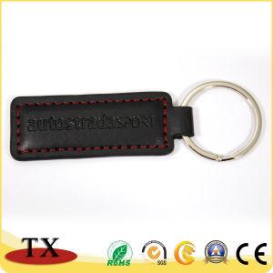 Прямоугольник в реальном из черной кожи с помощью клавиши с логотипом штампа кольцо
