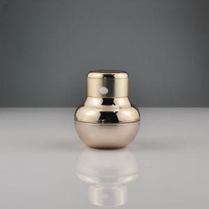 マッサージャーが付いている金の厚い壁のアクリルの装飾的な瓶50ml