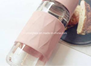 シリコーンの箱およびハンドル380mlと結ばれた薄い色のホウケイ酸塩水ガラスビン