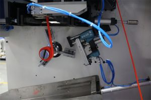 Macchina automatica di taglio e di bobina delle alte tessiture resistenti efficienti