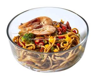 Il commestibile ispessisce l'insalata pura vuota della ciotola di vetro ed il contenitore di vetro della frutta