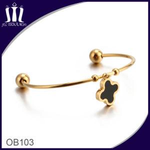 Parentesi graffa piacevole di colore dell'oro del braccialetto dei monili del metallo lasciata con la sfera ed il fascino Ob103