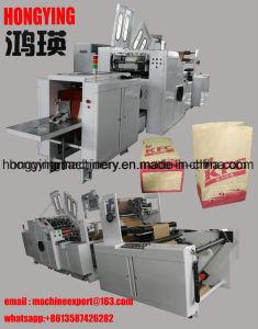 엄지 장치를 가진 기계를 만드는 음식 종이 봉지