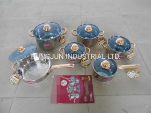 Asas de oro de 12 piezas de acero inoxidable utensilios de cocina en la tapa de cristal azul