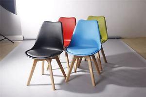 革クッション及び純木の足を搭載する椅子を食事している4セットのチューリップ