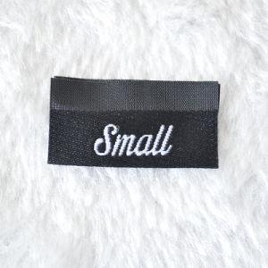 Fondo azul etiqueta tejida para prendas de vestir