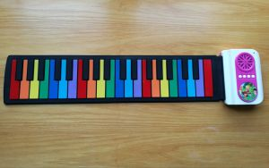 Het Muzikale Speelgoed van het jonge geitje - de Piano van het Broodje van de Hand van de Kleur met 8 Tonen