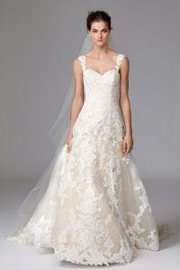 Klassisches Braut-Kleid mit großen Blumenspitze-Motiven in einer neuen Spitze