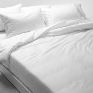 Insiemi bianchi del lenzuolo della pianura piena del cotone di alta qualità