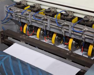 Documento automatico multifunzionale che fende e macchina di riavvolgimento