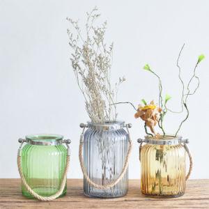 Стекло висящих вазы с помощью веревки