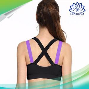 La cinghia della traversa di yoga di forma fisica spinge verso l'alto il reggiseno di sport delle donne