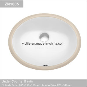 La Chine lavabo en céramique en vertu de compteur du bassin de lavage pour salle de bains (ZN1015)
